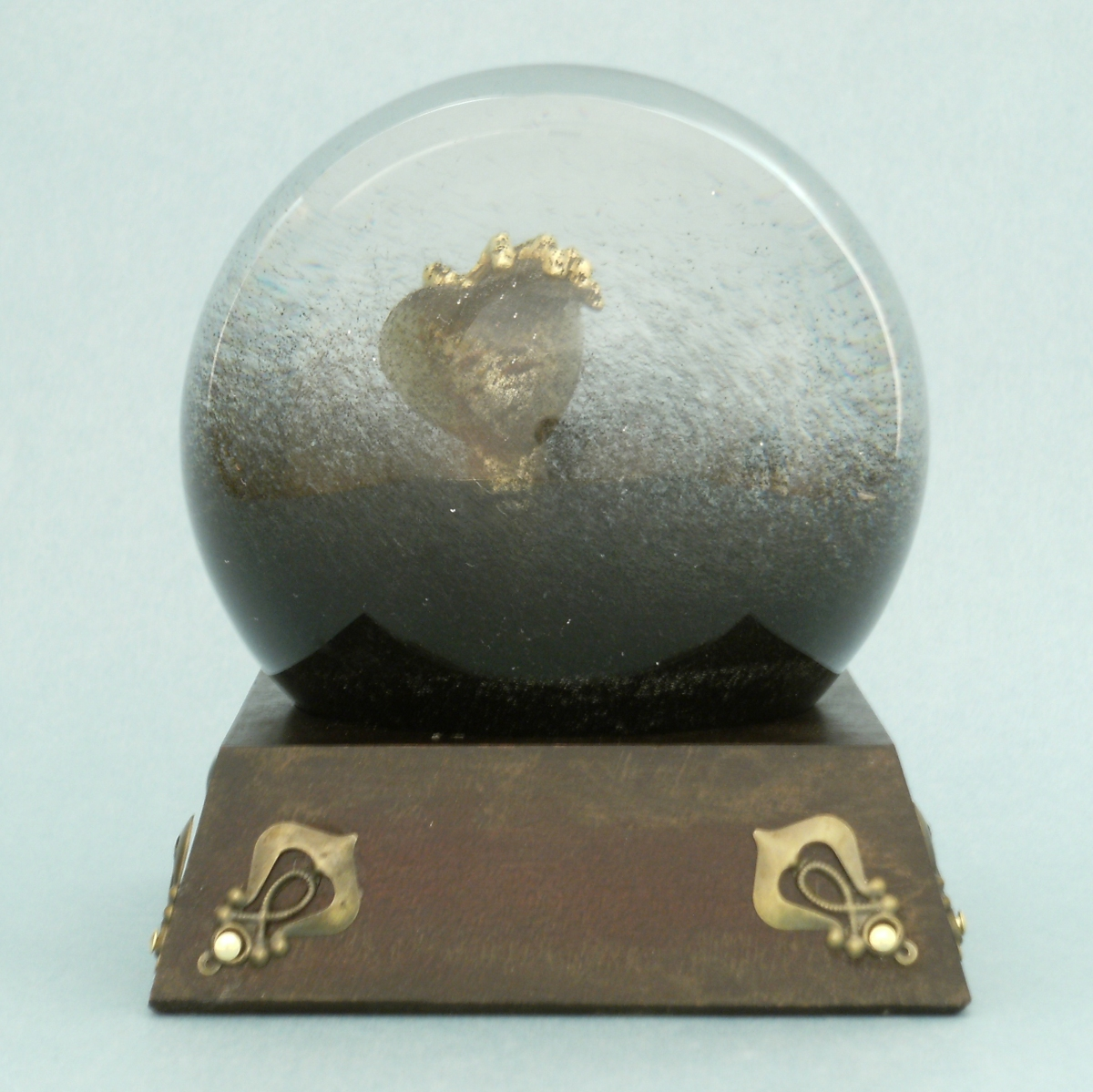 Heart of Darkness snow globe