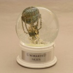Uncharted Skies snow globe