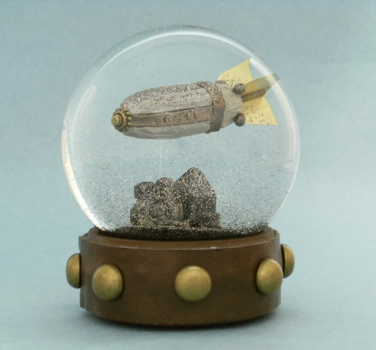 Airship over Rooftops snow globe by Camryn Forrest Designs