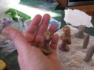 Sculptng miniature head for a snow globe, Camryn Forrest Designs, Denver Colorado