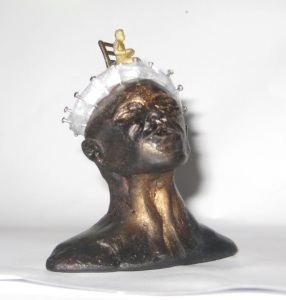 Shrink Wrap miniature head sculpture in snow globe, Camryn Forrest Designs, Denver Colorado