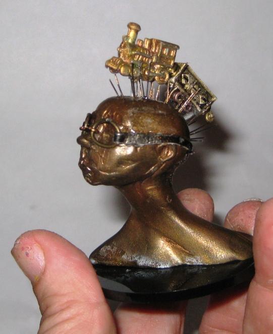 Train of Thought, miniature head sculpture in snow globe, Camryn Forrest Designs, Denver Colorado